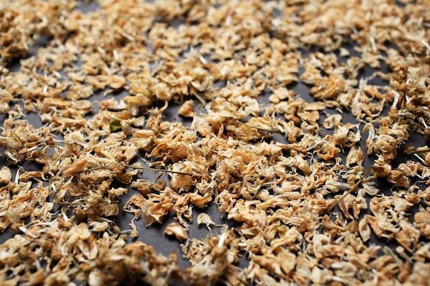 Close-up pattern photo of dried robinia pseudoacacia flowers.