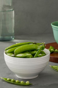 Close-up pea pods in bowl
