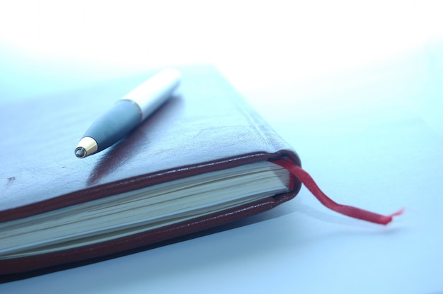 Close-up of pen on an agenda