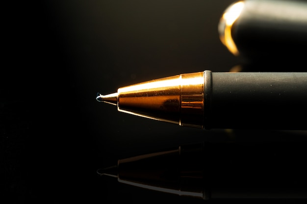 Close up of a pen on black background