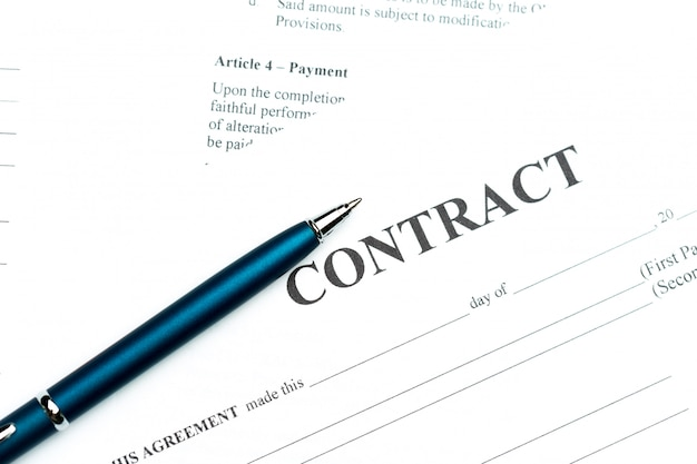 Close-up of pen on contract