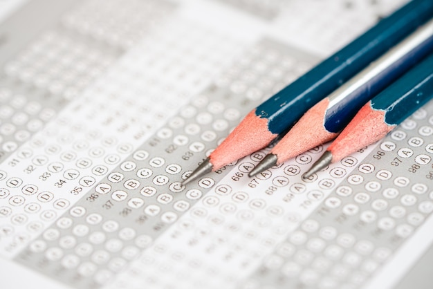 Close up pencil on the answer sheet for test score sheet with answers
