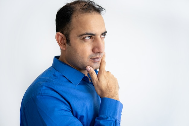 Close-up of pensive mid adult businessman touching chin