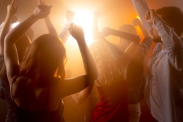 Close up people having fun at club