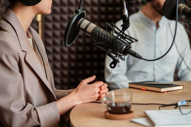 Close-up people speaking at radio