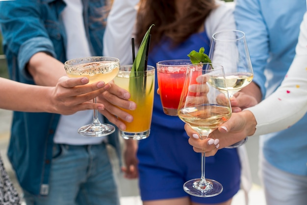 Close-up of people toasting at a party