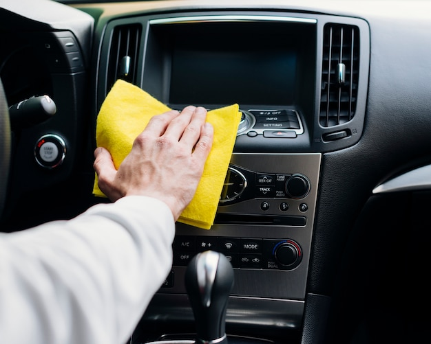 Close up of person cleaning car interior