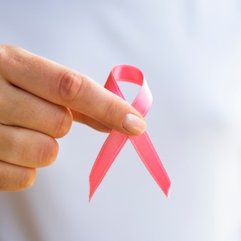Close-up person holding awareness ribbon