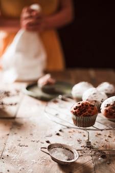 Close-up of a person preparing chocolate muffins