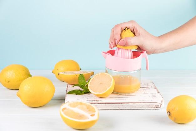Close up person preparing lemonade