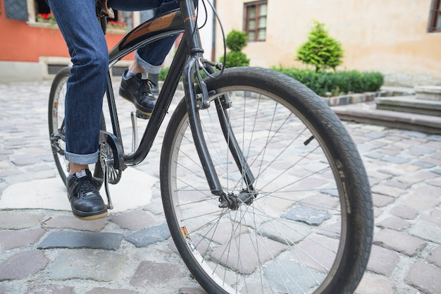 Close-up of a person's feet riding bicycle
