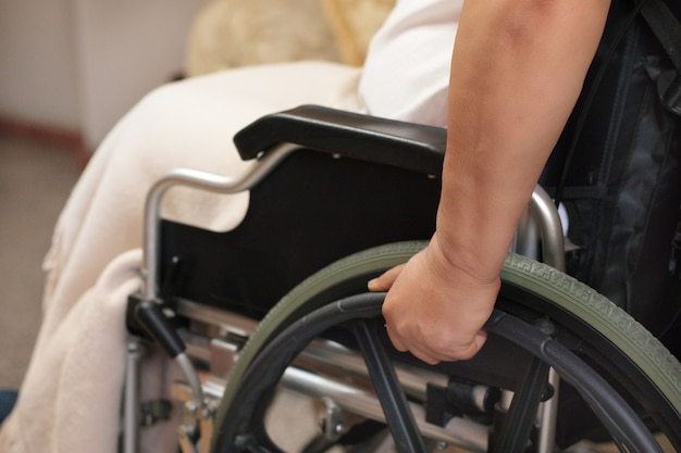 Close up of a person in a wheelchair