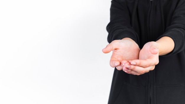 Close-up of a person with cupped hands