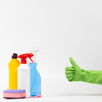 Close-up person with green glove showing approval
