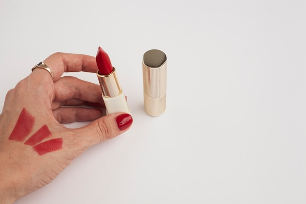 Close-up person with red lipstick and nails
