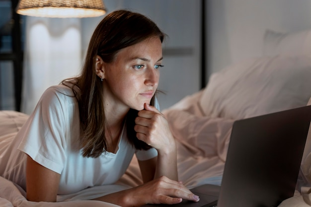 Close up on person working at home at night