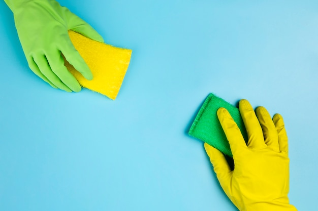 Close-up persons with different gloves and sponges
