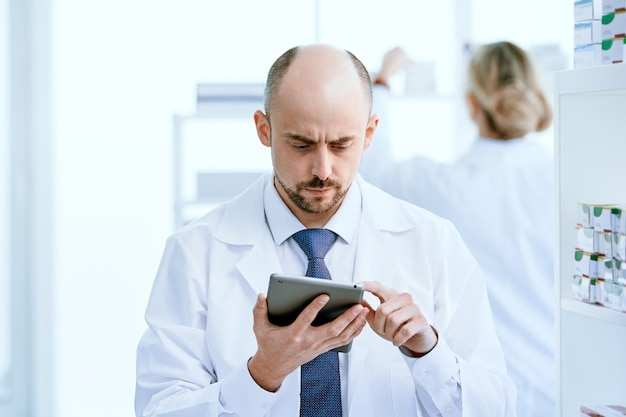 Close-up. pharmacist using a digital tablet at his workplace .