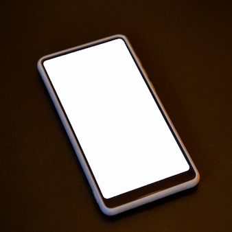 Close-up phone with white screen mock-up