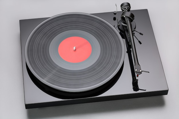 Close up to phono cartridge on tonearm of vintage analog, hi fi stereo vinyl turntable with copy space.