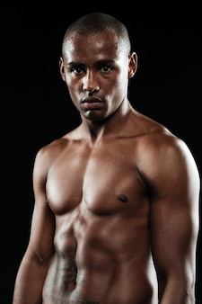 Close-up photo of afroamerican boxer resting after fight