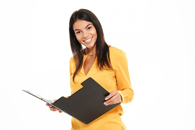 Close-up photo of attractive caucasian woman working with documents