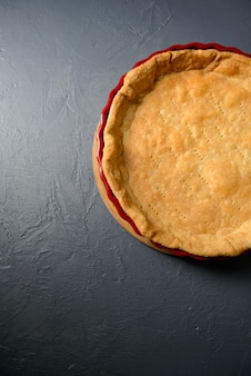 Close-up photo of baked tart dough, cooking pie