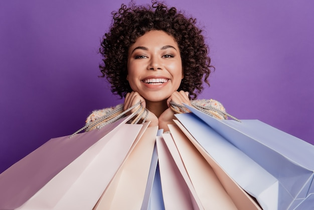 Close up photo beautiful girl carry many shopping packages adorable smile