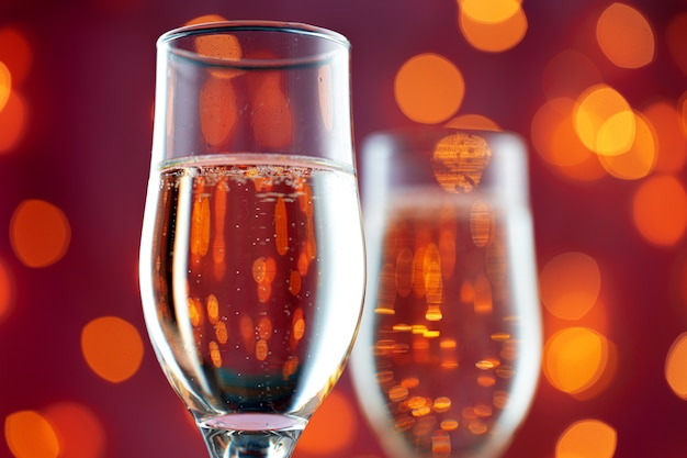 Close up photo of champagne glasses against bokeh background