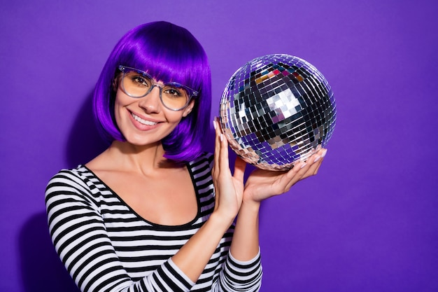 Close up photo of charming millennial holding mirror ball wear specs isolated over purple violet background