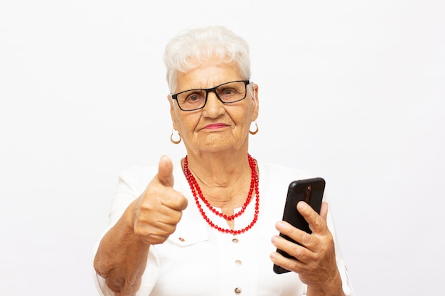 Close up photo of cheerful confident excited dreamy with wavy hair old granny lady taking making self portrait isolated grey background