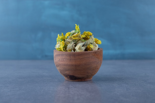 Close up photo of dried flower on wooden bowl. .
