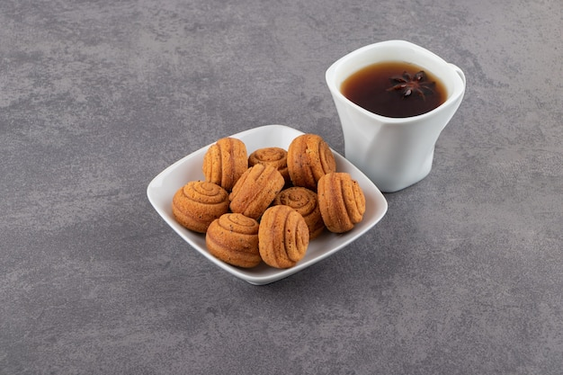 Close up photo of fresh cookies with cup of tea