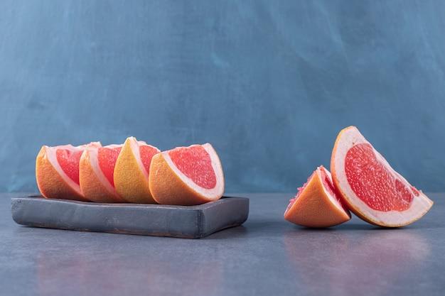 Close up photo of fresh grapefruit slices.