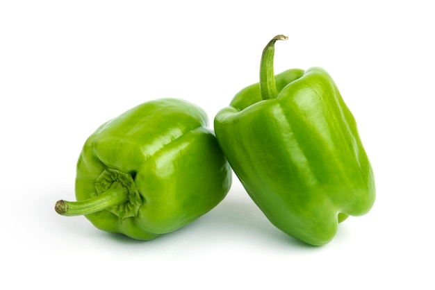 Close up photo of fresh organic peppers isolated on white surface.
