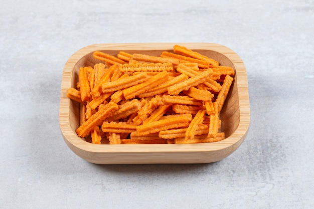 Close up photo of fries in wooden bowl