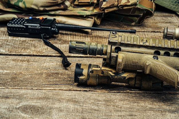 Close up photo of m16 rifle on wooden board