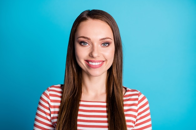 Close up photo of nice attractive girl look good mood toothy smile wear casual style clothes pullover isolated over blue color background