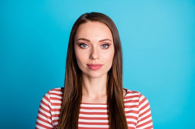 Close up photo of nice girl look in camera concentrated wear casual style pullover isolated over blue color background