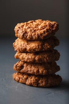 Close-up photo of oatmeal cookies stack on gray surface
