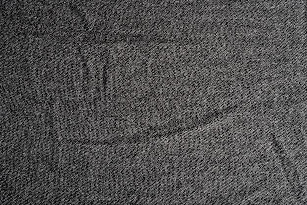 Крупным планом фото текстуры черной ткани