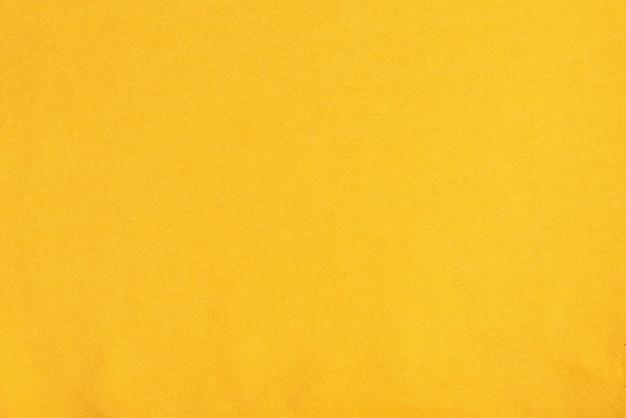 Крупным планом фото светло-желтой ткани текстуры