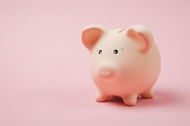 파스텔 핑크색 벽 배경에 격리된 분홍색 돼지 저금통의 사진을 닫습니다. 돈 축적, 투자, 은행 또는 비즈니스 서비스, 부의 개념. 공간 광고를 조롱하십시오.