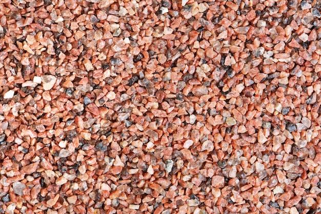 붉은 모래 질감의 클로즈업 사진입니다. 고해상도 배경입니다.