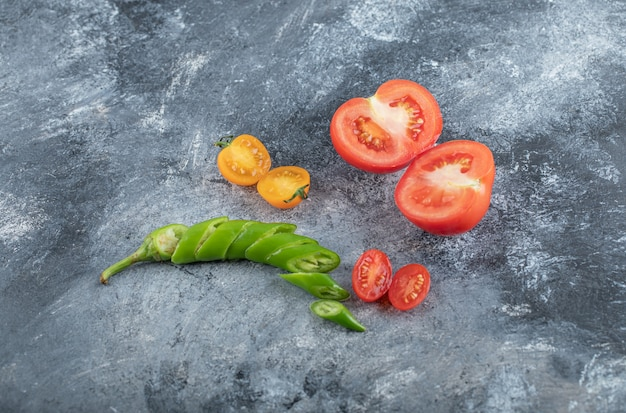 Close up photo of organic sliced vegetables. tomato, green pepper. high quality photo