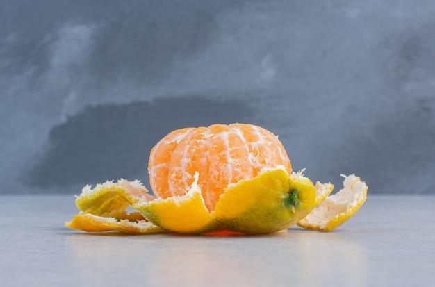 Close up photo of peeled fresh tangerine.