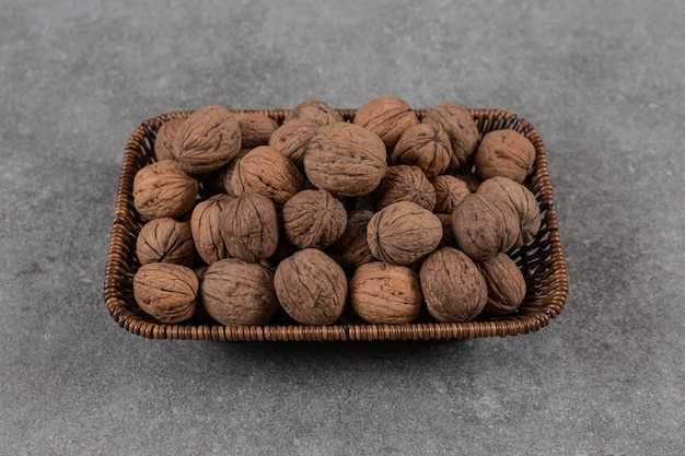 Close up photo of pile of walnuts in basket.