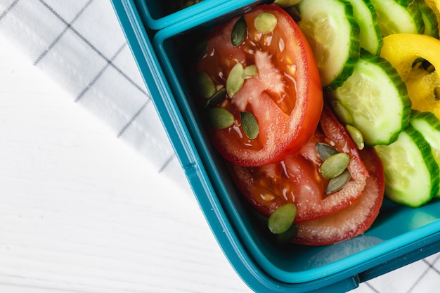 Close up photo of plastic lunch box with cooked food