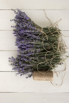 A close-up photo of provencal fragrant lavender lying on table. medicinal aromatherapy. top view