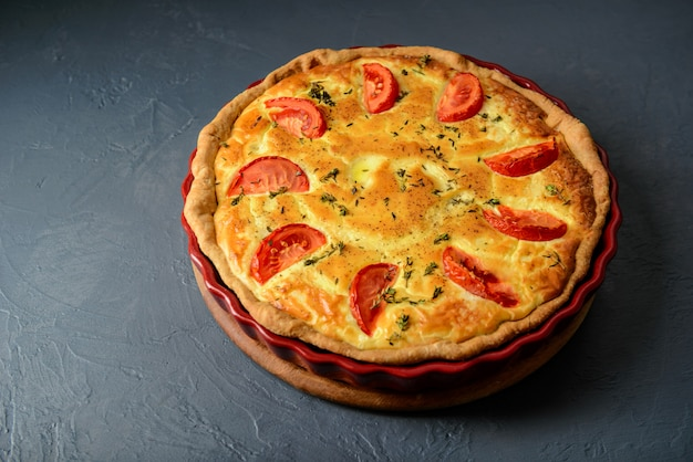 Close-up photo of quiche lorraine pie with tomatoes